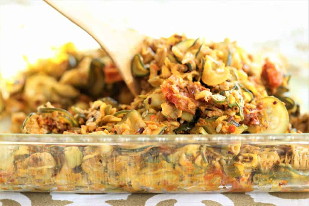 Zucchini is abundant this summer, so we need more dishes that feature this awesome vegetable. Although zucchini ca Zucchini Rice With Roasted Red Pepper Pesto is flavorful and filling.