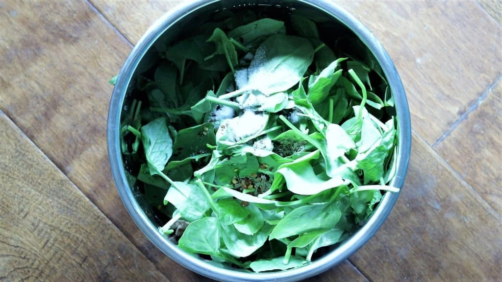 Add spinach, spices