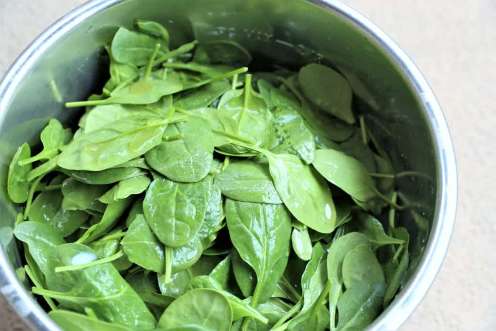 Add spinach and liquids