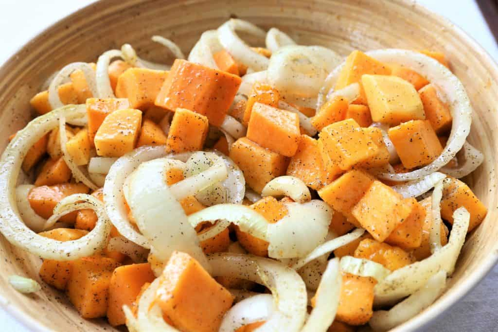 Mix butternut, onions and garlic with olive oil, maple syrup, salt and pepper