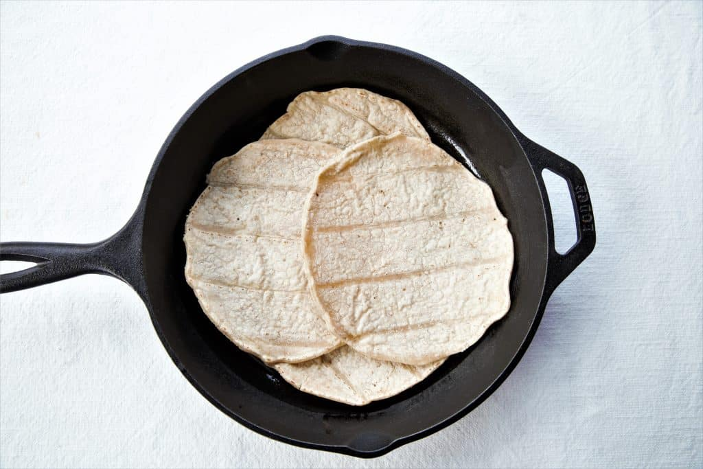 Cast iron pan with tortillas