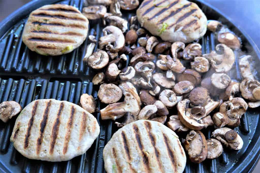 Mushrooms and jackfruit burgers on the grill