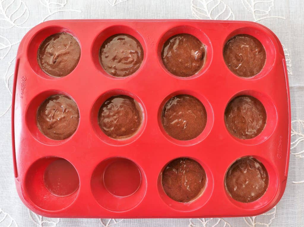 Grease silicon muffin pan with coconut oil. Bake at 320 for 25 minutes