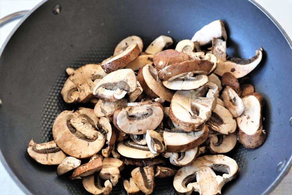 Add mushrooms to pan