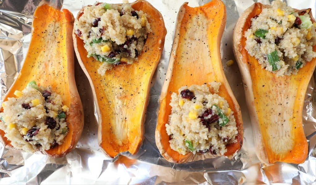 Stuff squash with quinoa mixture. Bake for 30 minutes at 375 degrees