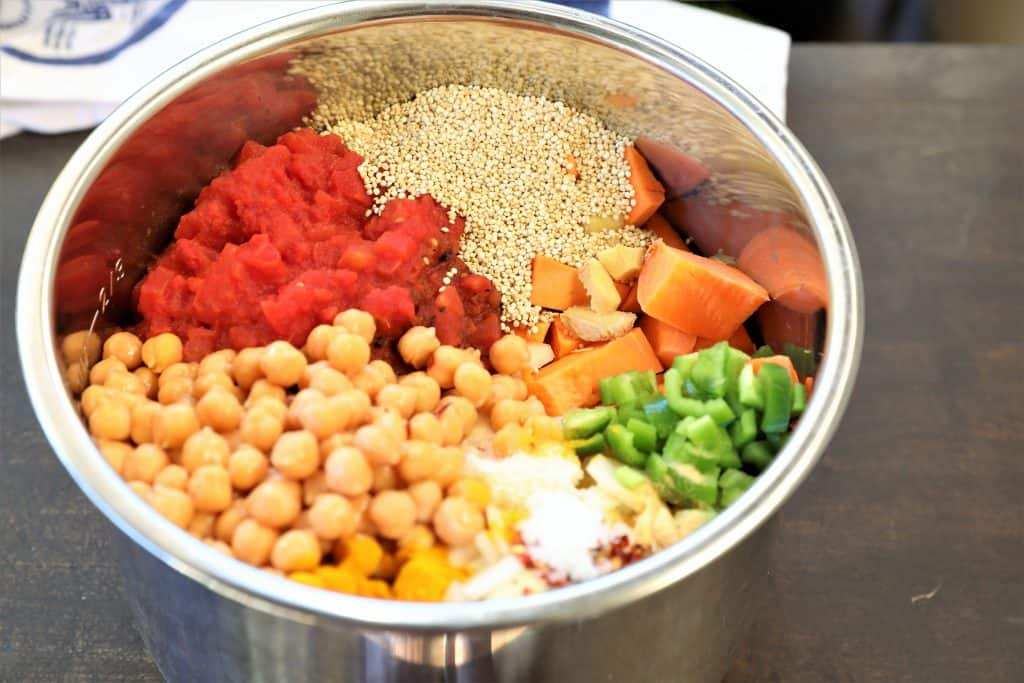Add chickpeas, quinoa, tomatoes and spices