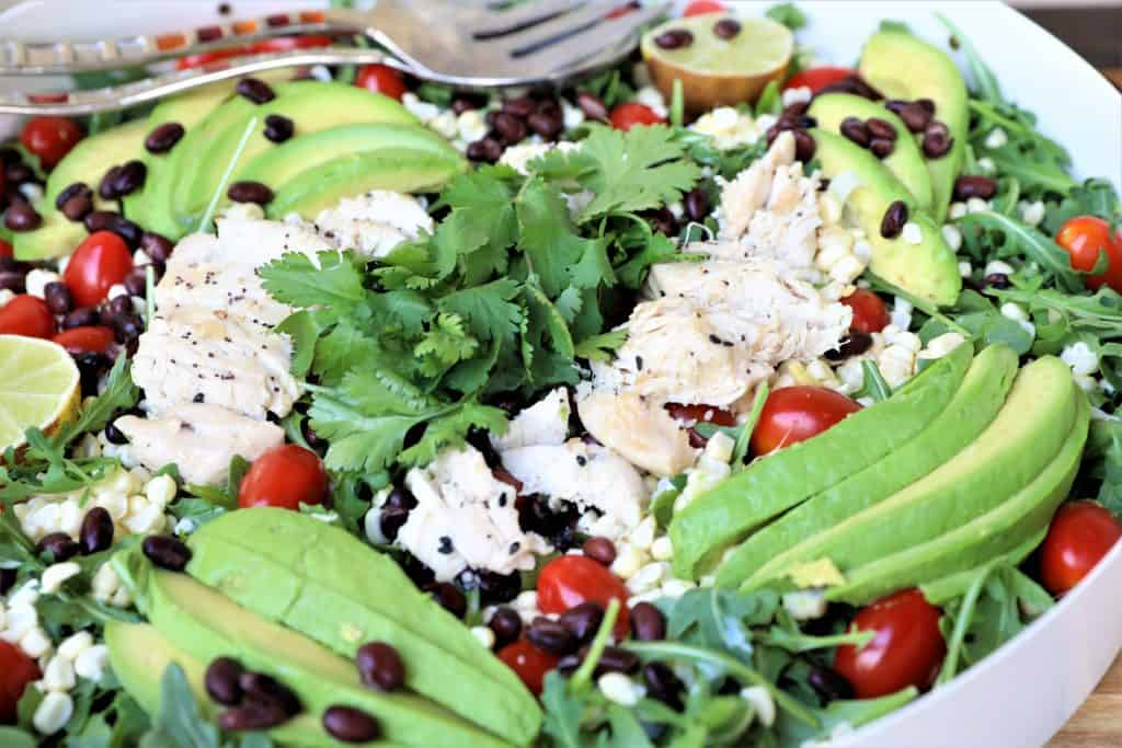 Add chicken, black beans, avocado and cilantro