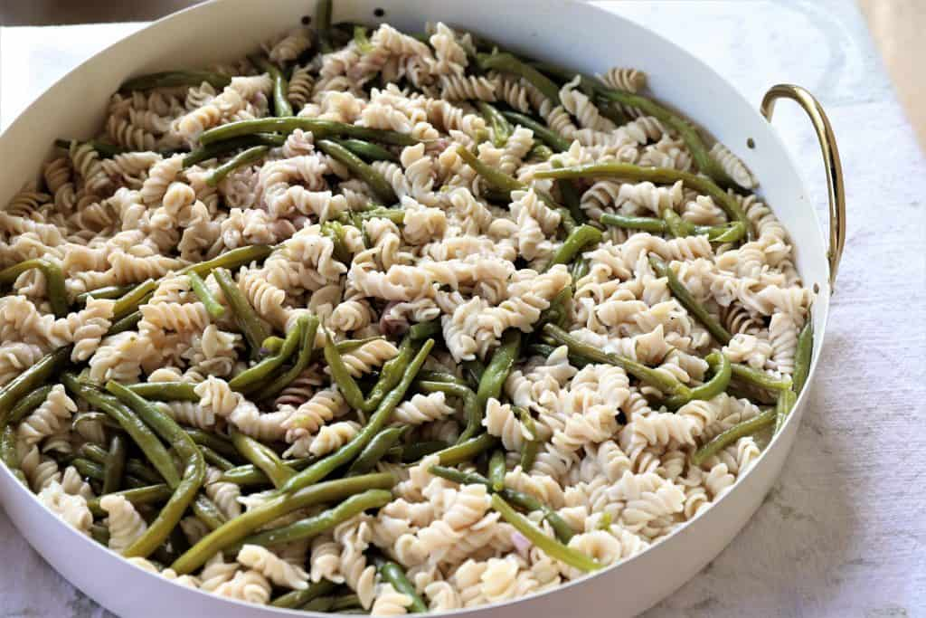 Drain pasta and beans in colander and rinse with cold water.Add to large bowl or platter