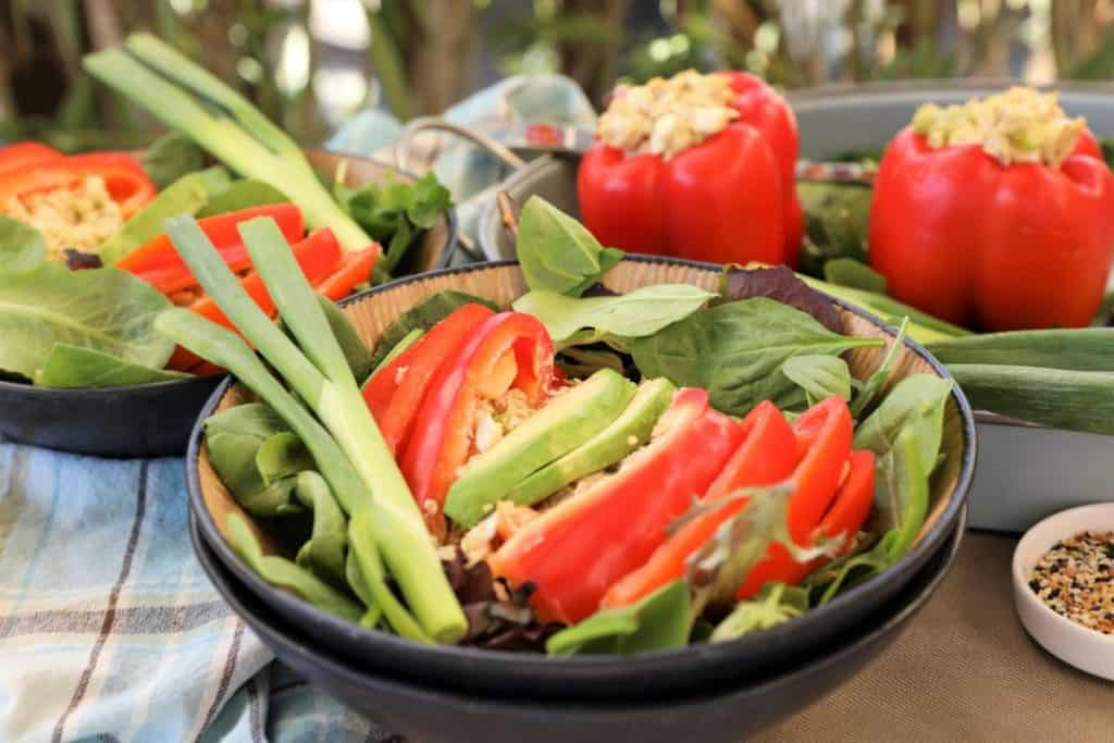 Serve stuffed pepper with greens