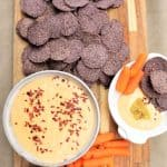 Vegan Queso Dip with chips and carrots