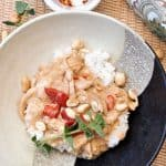 Bowl of Spicy Peanut Chicken with herbs