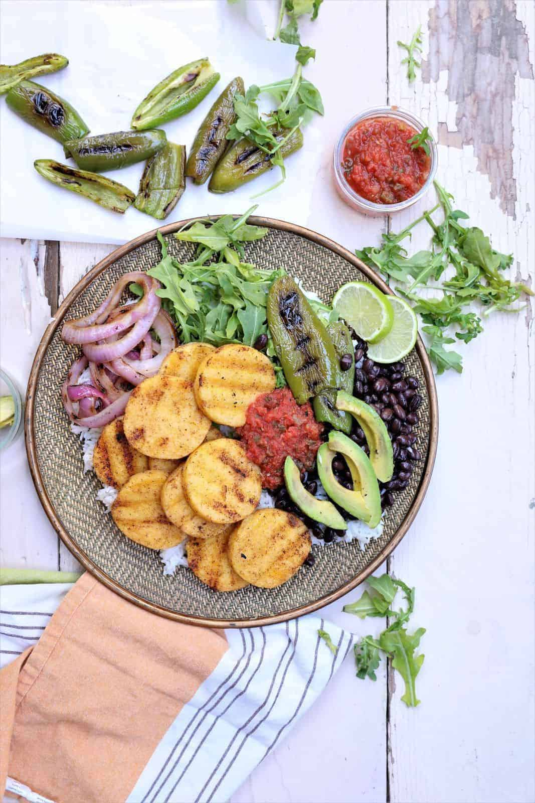 Grilled Polenta Bowl with jalapenos, avocados and napkin