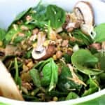 Add spinach, vegetables and spices to bowl and toss